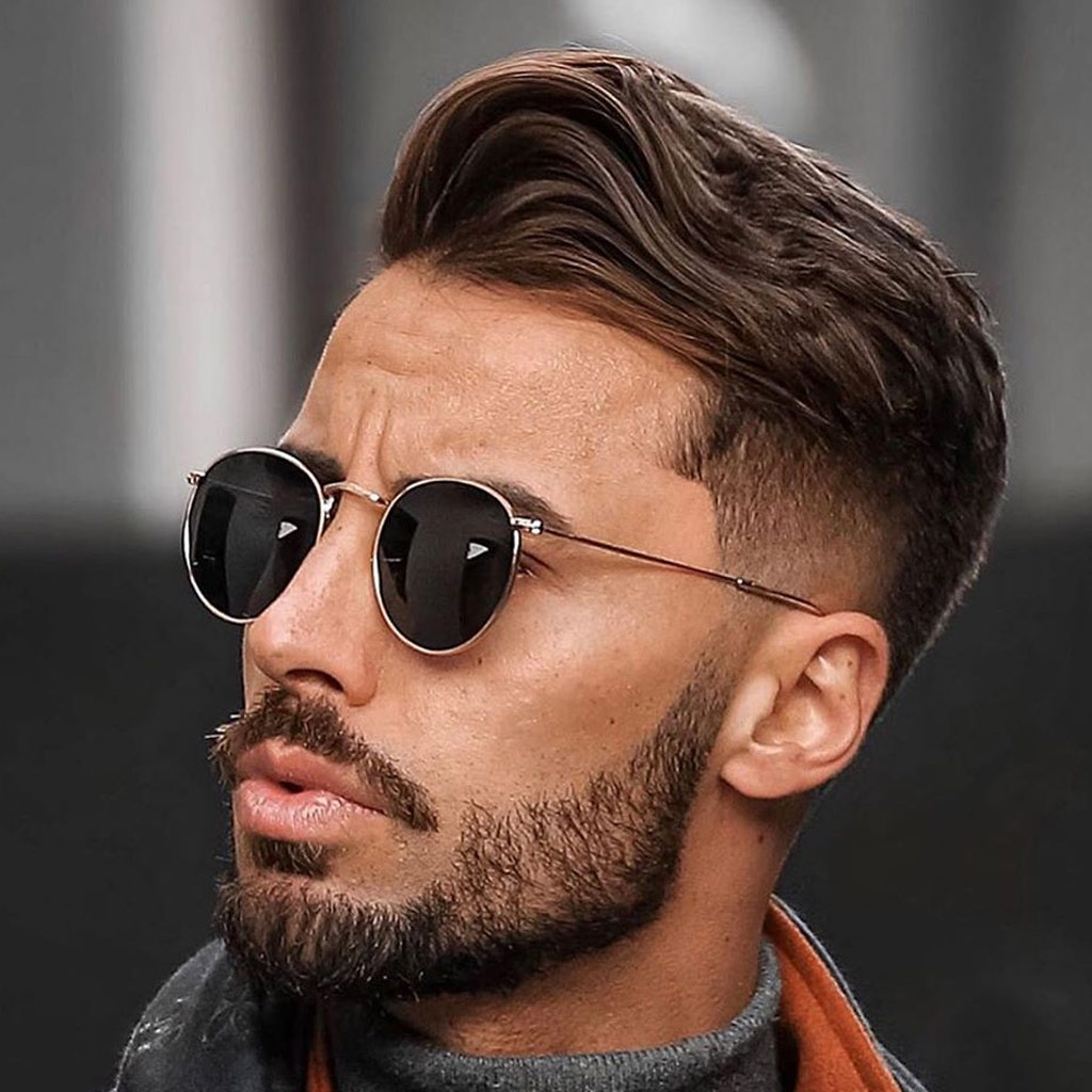 4 mens hairstyle low fade wavy slickback with beard